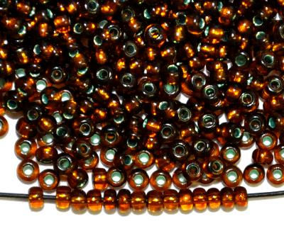 Best.Nr.:12066 Rocailles von Preciosa Tschechien,  topas mit Silbereinzug und grün gefärbten Loch,