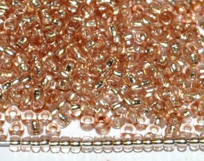 Best.Nr.:11199 Rocailles von Preciosa Ornella Tschechien, light apricot transp. mit Silbereinzug