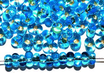 Best.Nr.:00821 Farfalle Rocailles von Ornella Preciosa Tschechien türkis transp. mit Silbereinzug