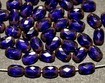 Best.Nr.:28406 facettierte Glasperlen Oliven blau transp. mit Bronze Veredelung