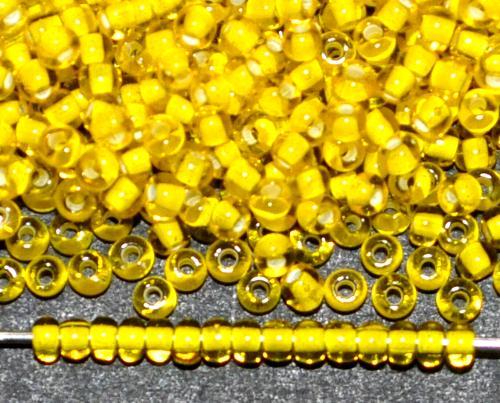 Best.Nr.:12005 Rocailles von Ornella Preciosa Tschechien, gelb transp. mit Farbeinzug weiß