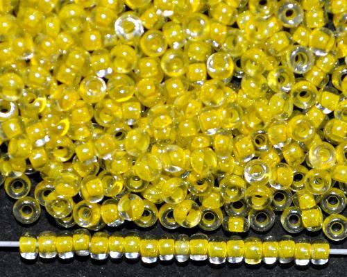 Best.Nr.:12018  Rocailles von Preciosa Ornella,  kristall mit Farbeinzug gelb und lüster,  hergestellt in Gablonz / Tschechien