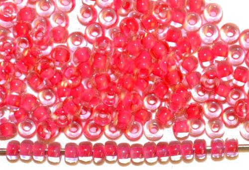 Best.Nr.:12053 Rocailles von Preciosa Ornella,  kristall mit Farbeinzug himmbeerrot,  hergestellt in Gablonz / Tschechien