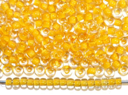 Best.Nr.:12079  Rocailles von Preciosa Ornella,  kristall mit Farbeinzug gelb,  hergestellt in Gablonz / Tschechien