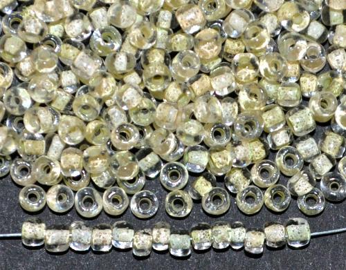 Best.Nr.:12106 Rocailles von Ornella Preciosa Tschechien,  kristall mit Farbeinzug blass grüngelb