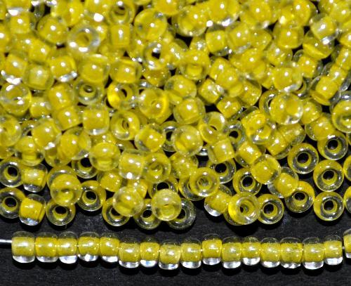 Best.Nr.:12125 Rocailles von Preciosa Ornella Tschechien,  kristall mit Farbeinzug gelb und lüster,