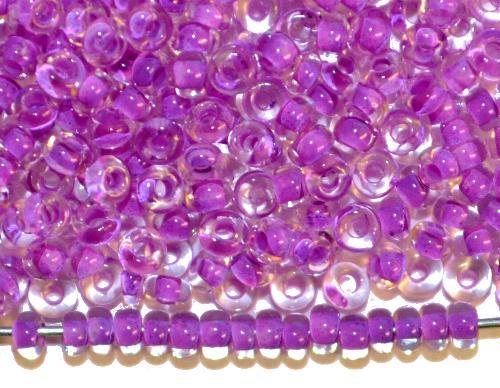 Best.Nr.:12150 Rocailles von Preciosa Ornella, kristall mit Farbeinzug violett, hergestellt in Gablonz / Tschechien