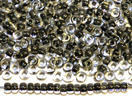 Best.Nr.:12154  Rocailles von Preciosa Ornella,  kristall mit Farbeinzug schwarz,  hergestellt in Gablonz / Tschechien