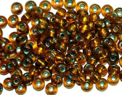 Best.Nr.:11196 Rocailles von Preciosa Tschechien, topas mit Silbereinzug und grün gefärbten Loch,