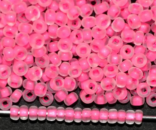 Best.Nr.:14082/100  Rocailles von Ornella Preciosa Tschechien  kristall mattiert (frostet) mit Farbeinzug neon pink