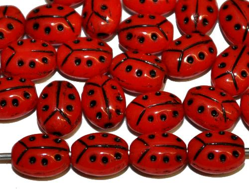 Best.Nr.:51095  Glasperlen Marienkäferchen  Vorder-und Rückseite geprägt  rot opak mit Goldauflage,  hergestellt in Gablonz / Tschechien