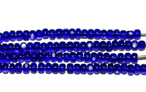 Best.Nr.:77041  Cut Rocailles / Charlottes (angeschliffene Rocailles) von Ornella/Preciosa Tschechien  dunkelblau transp.