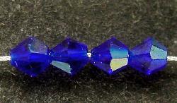 Best.Nr.:31018 mc-Schliff Glasperlen dunkelblau mit AB bicon