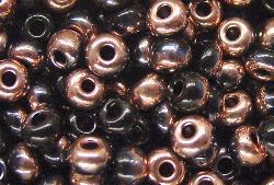 Best.Nr.:07054 Rocailles von Ornella Preciosa Tschechien,  schwarz / hellkupfer eine Hälfte der Perle mit Metallicüberzug