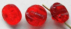 Best.Nr.:43052  Glasknöpfe, geprägt, rot transparent  Von der Firma Josef Feix in Johannesberg / Böhmen vor 1920 hergestellt.