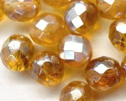 Best.Nr.:28281 facettierte Glasperlen  honiggelb transp. mit AB und lüster