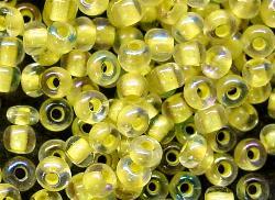Best.Nr.:12095 Rocailles  kristall mit Farbeinzug gelb  /schillernd (irisierend)